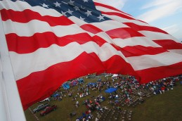 A large American flag attached to the McComb Fire DepartmentÕs ladder truck flies high in the air over a large crowd gathered at New Heights Baptist ChurchÕs annual Independence Day celebration in Summit, Mississippi on Sunday July, 2007.